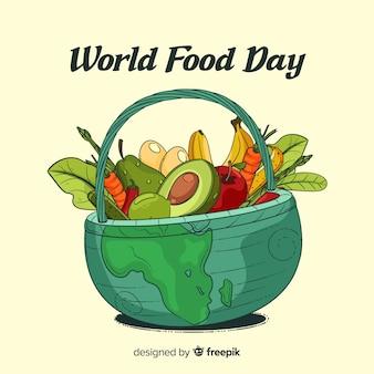 Giorno dell'alimento mondiale disegnato a mano in un cestino