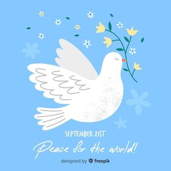 Giorno di pace disegnato a mano con una colomba