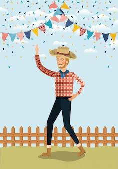 Giovane agricoltore festeggia con ghirlande e recinzione
