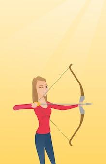 Giovane arciere caucasico che si prepara con un arco