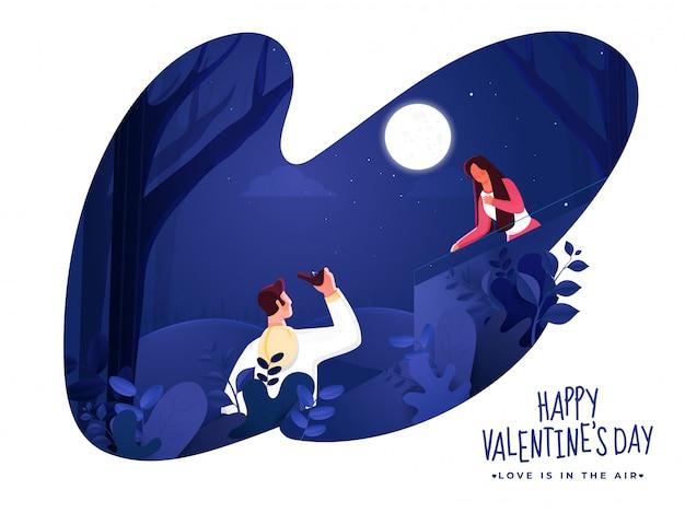 Giovane che propone donna sul fondo di scena di notte della natura del taglio della carta per la celebrazione felice di san valentino.