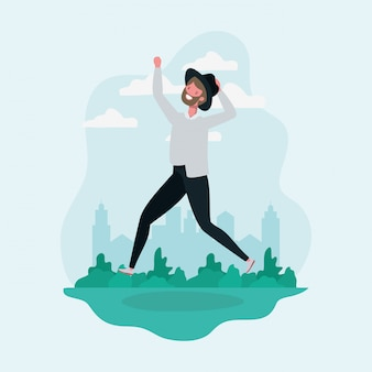 Giovane con barba e cappello saltando nel carattere del parco