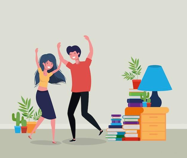 Giovane coppia che balla nel soggiorno