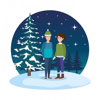 Giovane coppia con abiti invernali in snowscape