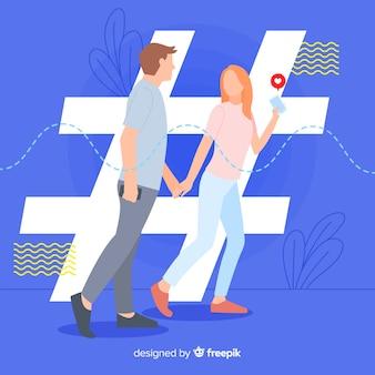 Giovane coppia con simbolo hashtag