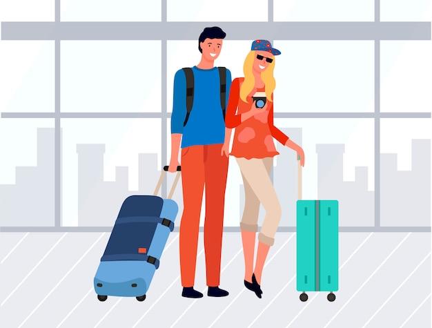 Giovane coppia di turisti con bagagli