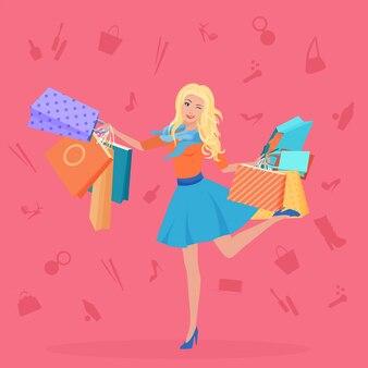 Giovane donna bionda con borse della spesa