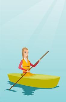 Giovane donna caucasica che viaggia in kayak.