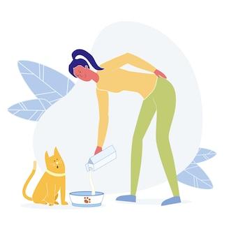 Giovane donna che alimenta cat flat