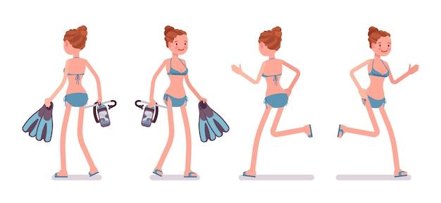 Giovane donna che cammina e corre con maschera e pinne