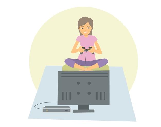 Giovane donna che gioca sul suo televisore a schermo piatto