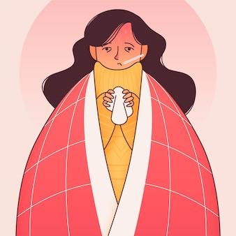 Giovane donna che ha un raffreddore