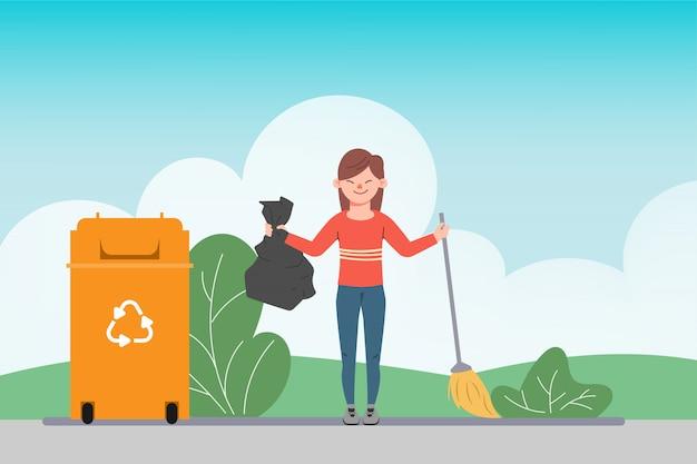 Giovane donna che pulisce e che mantiene i rifiuti nell'immondizia. salva il concetto di ambiente.