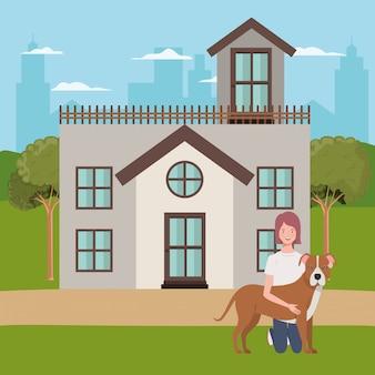 Giovane donna con cane carino all'aperto di casa