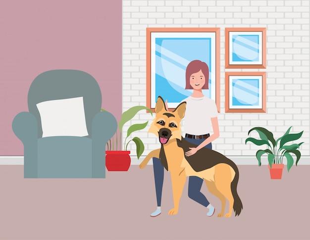 Giovane donna con cane carino in salotto