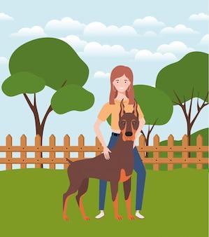 Giovane donna con cane carino nel campo