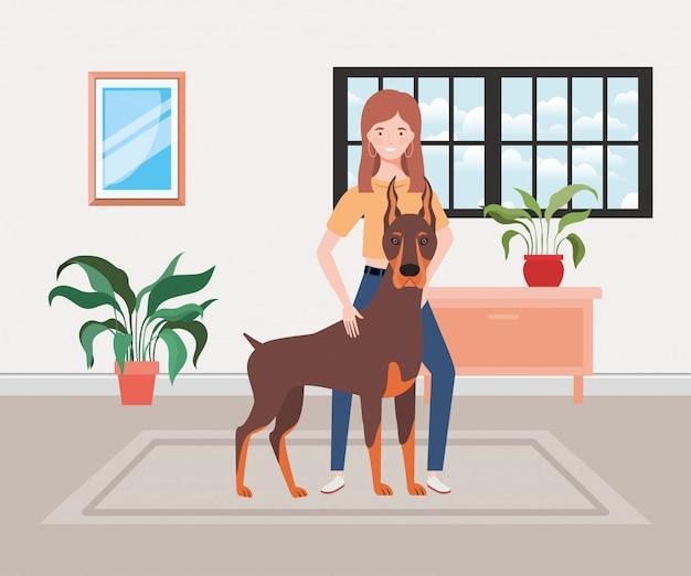 Giovane donna con cane carino nella stanza di casa