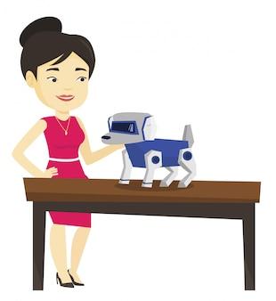 Giovane donna felice che gioca con il cane robot.