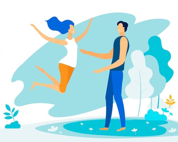 Giovane donna felice che salta nelle braccia dell'uomo, amore