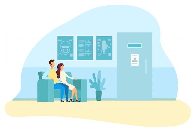 Giovane famiglia in attesa nel corridoio per la diagnosi di risonanza magnetica