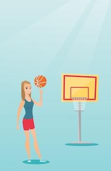 Giovane giocatore di pallacanestro caucasico che fila una sfera.