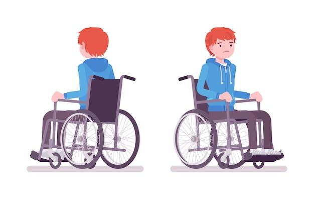 Giovane maschio su sedia a rotelle