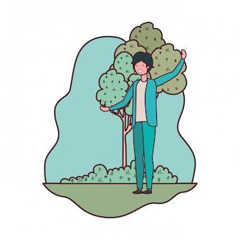 Giovane nel paesaggio con alberi e piante