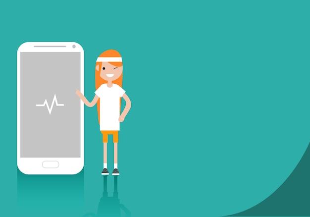 Giovane personaggio in abiti sportivi in piedi vicino a smartphone.