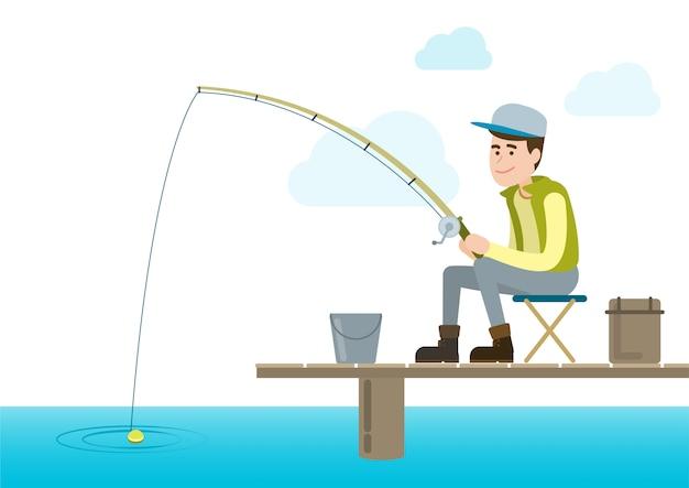 Giovane pescatore con canna da pesca