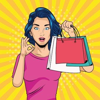 Giovane ragazza con le borse della spesa in stile pop art carattere