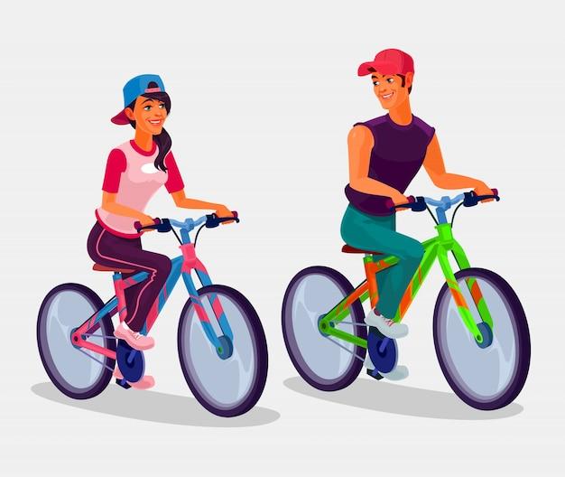 Giovane ragazzo e ragazza che guidano biciclette