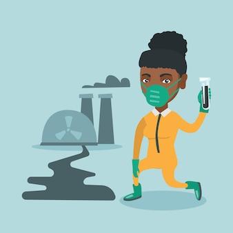 Giovane scienziato africano che tiene una provetta.