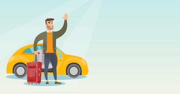 Giovane uomo caucasico che fluttua davanti all'automobile.