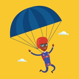Giovane uomo felice volando con il paracadute.
