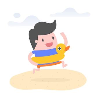 Giovane uomo sulla spiaggia con anello di nuotata di anatra di gomma.
