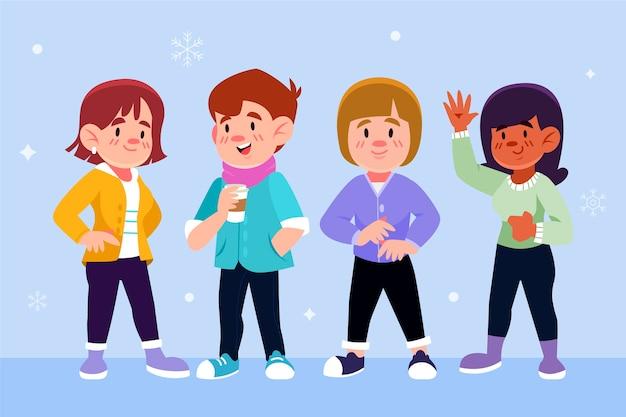 Giovani che indossano abiti invernali