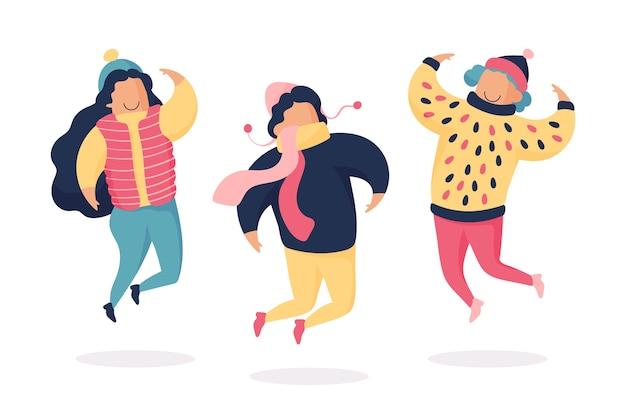 Giovani con abiti invernali saltando
