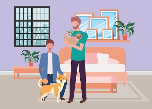 Giovani con simpatici cani mascotte in camera da letto