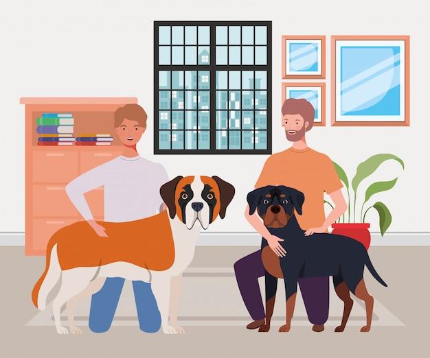Giovani con simpatici cani mascotte in casa