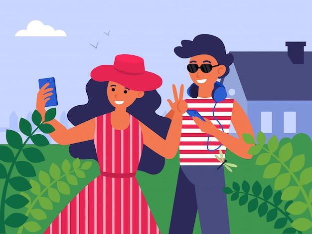 Giovani coppie che prendono selfie