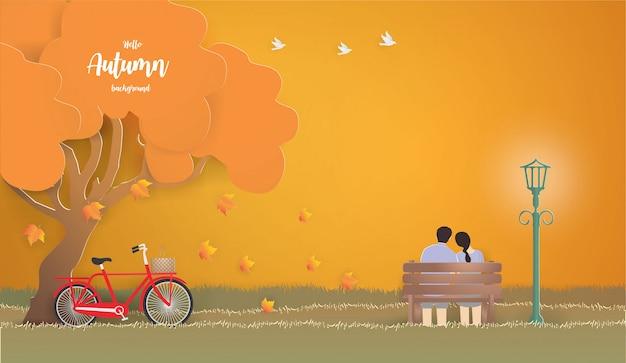 Giovani coppie che si siedono a parte sul banco nell'illustrazione di autunno.