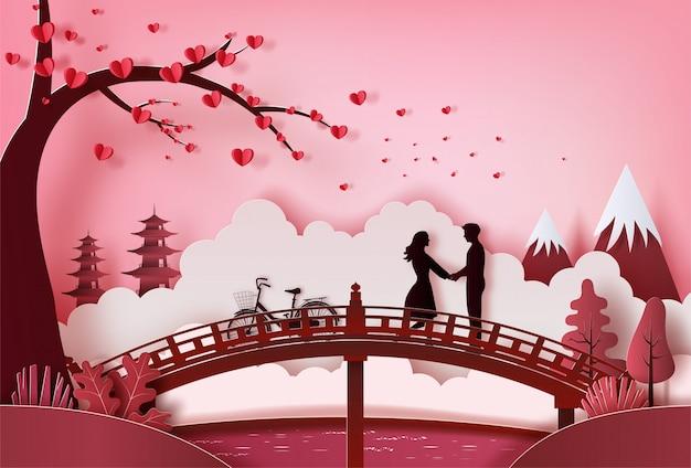 Giovani coppie che si tengono per mano nel parco con bello fondo, stile di arte di carta.