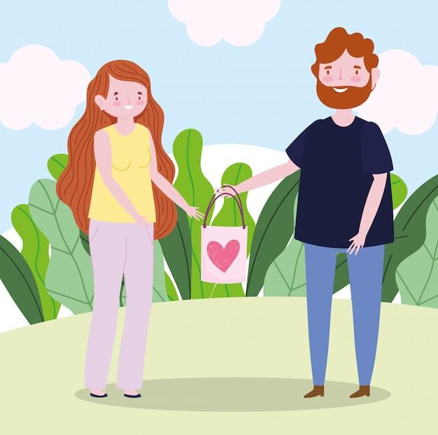 Giovani coppie con il sacchetto del regalo amano il fumetto romantico del cuore