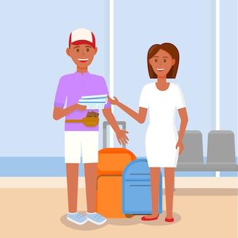 Giovani coppie felici con la borsa sul fondo del terminale