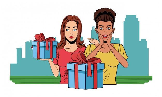 Giovani donne con una confezione regalo pop art