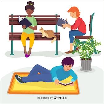 Giovani personaggi del design piatto che leggono all'aperto