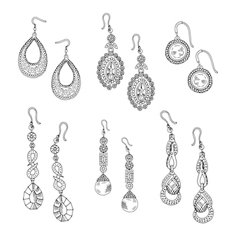 Gli orecchini disegnati a mano hanno messo - i gioielli isolati su fondo bianco