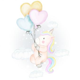 Gli unicorni volano con l'illustrazione dell'acquerello del pallone del cuore