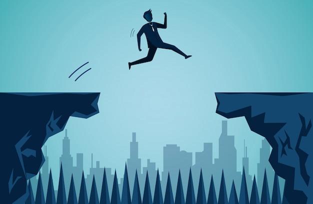 Gli uomini d'affari che saltano dalla scogliera alla scogliera opposta per raggiungere l'obiettivo di successo aziendale