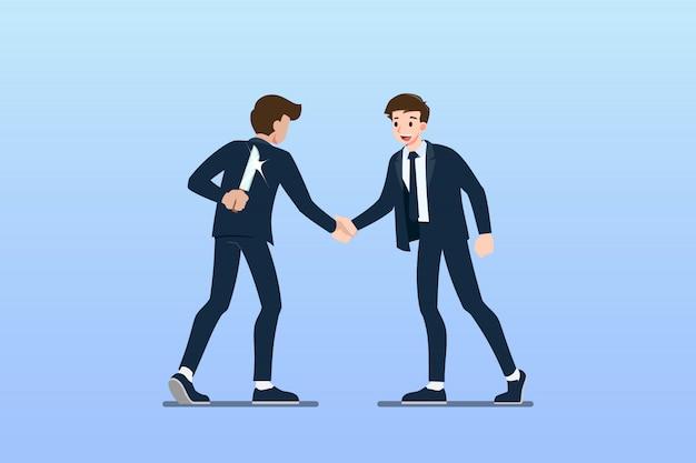 Gli uomini d'affari si stringono la mano. ma il primo pronto a tradire.